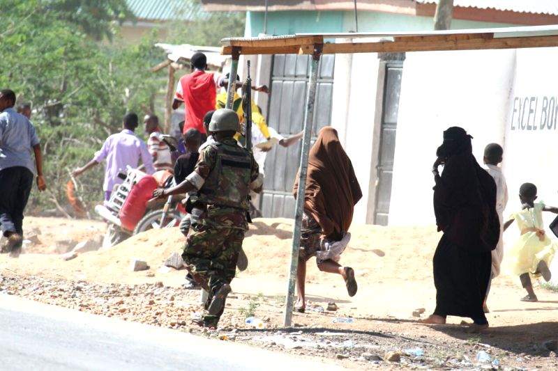A military personnel is seen near Garissa University College in Garissa, Kenya, April 2, 2015. Kenyan Interior Minister Joseph Nkaissery said the siege at the ... - Joseph Nkaissery