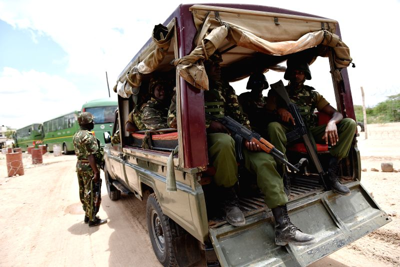 Survivor students leave for their homes by buses under protection in Garissa, Kenya, April 4, 2015. A total of 663 survivors from a Kenyan university attack left ...
