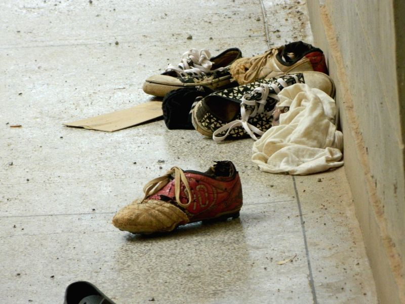 Photo taken on April 6, 2015 shows misplaced shoes after Al-Shabaab gunmen attacked the Garissa University College in Garissa, northeastern Kenya. At least 142 ...