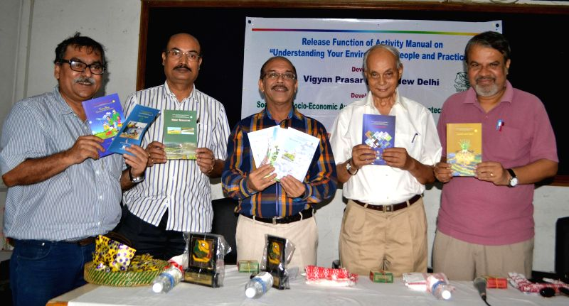 "Gauhati University Vice Chancellor and other dignitaries release Activity Manual on ""Understanding Your Environment, People and Practices"" during a programme at Press Club in  Guwahati on .."