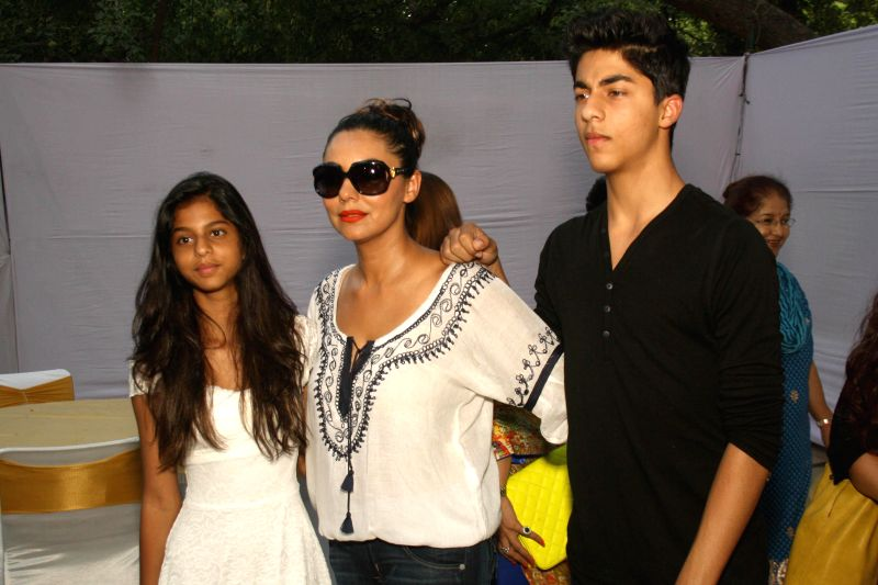 Gauri Khan, wife of actor Shah Rukh Khan with her son Aryan and daughter Suhana at the opening of new showroom and restaurant ``The Brown Box Bakery`` in New Delhi on June 28, 2014. - Shah Rukh Khan
