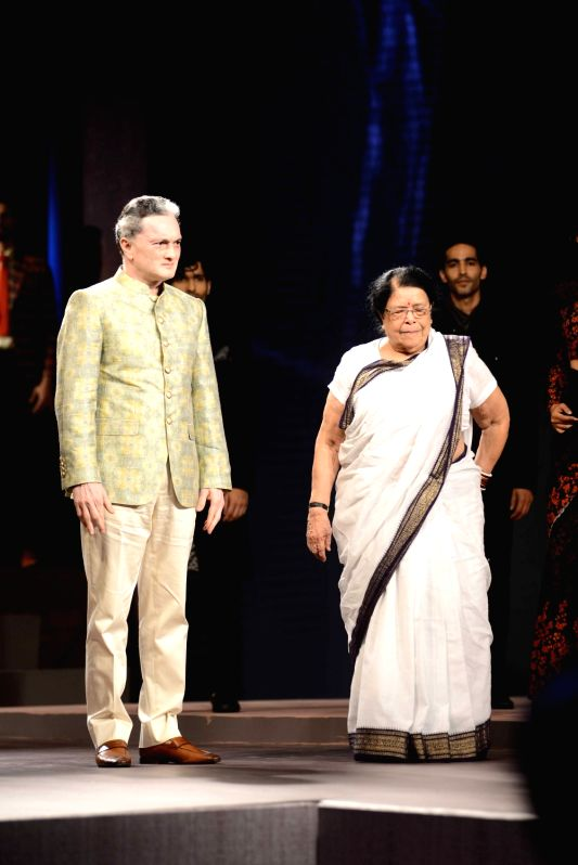 Gautam Singhania, CMD, Raymond Group with Sumitra Kulkarni Gandhi, granddaughter of Mahatma Gandhi during the fashion show with a theme Raymond Khadi - A Story Re - Spun in Mumbai, on May 18, ... - Sumitra Kulkarni Gandhi