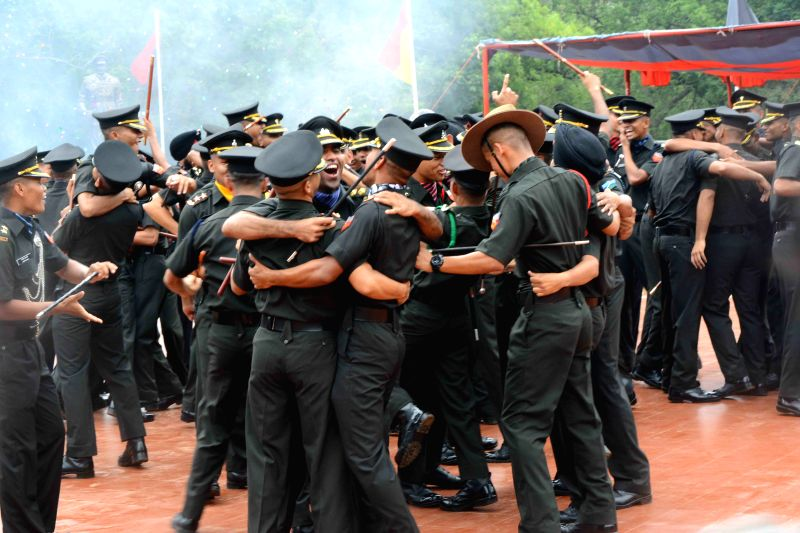Gentlemen cadets celebrate during the passing out parade (POP) of the seventh batch of trainees of the Officers' Training Academy (OTA) in Gaya on June 13, 2015.