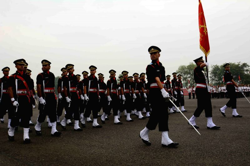 Gentlemen cadets participate in a march past during the passing out parade (POP) of the seventh batch of trainees of the Officers' Training Academy (OTA) in Gaya on June 13, 2015.