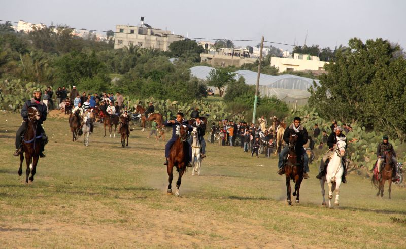 Palestinian men ride their horses as they compete in a local horse race in the southern Gaza Strip city of Khan Younis, on April 11, 2014.