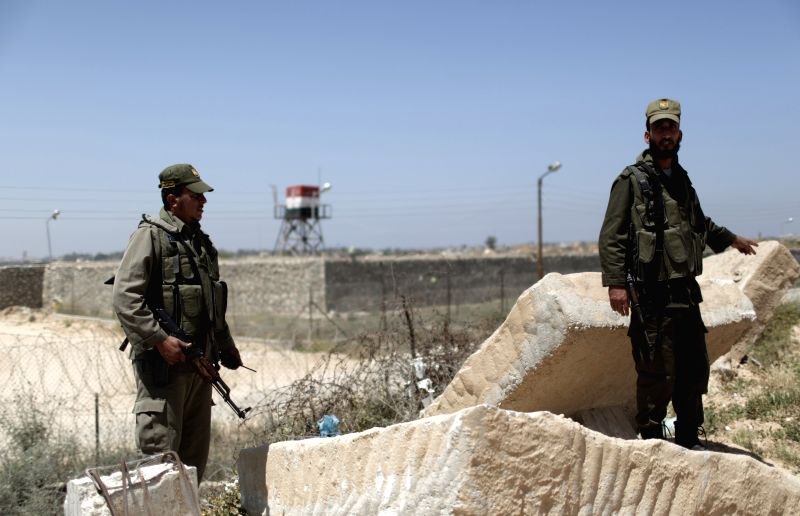 Palestinian Hamas policemen stand guard on the border between Egypt and the southern Gaza Strip on April 27, 2014. Rival Palestinian leaders from the West Bank and ..