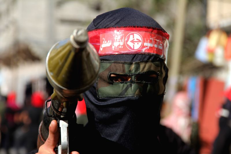 A Palestinian militant from the Popular Front for the Liberation of Palestine (PFLP) takes part in a military parade in the southern Gaza Strip City of Khan Yunis on .