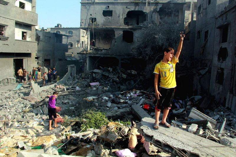 Palestinian children inspect the rubble of a destroyed house after an Israeli airstrike in the southern Gaza Strip City of Rafah, on Aug. 2, 2014. Israeli offensive ...