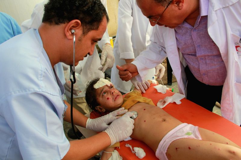 Palestinian medics treat a girl, who they said was wounded by an Israeli airstrike on their house, at a hospital in the southern Gaza Strip city of Rafah, on Aug. 2, ...