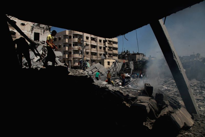 Palestinians search on the debris of a destroyed mosque after an Israeli airstrike in Gaza City, on Aug. 2, 2014. The Israeli offensive on the Gaza Strip has been going