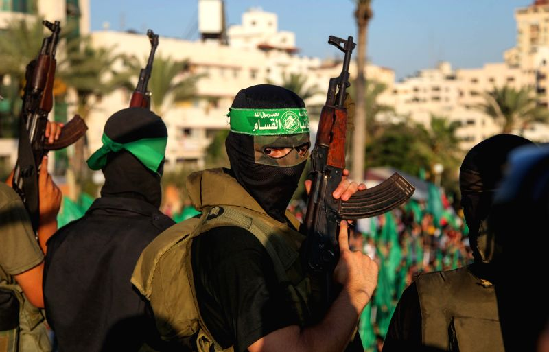 Fighters of the Ezzedine al-Qassam Brigades, a Hamas armed wing, takes part in a rally in Gaza City on Aug. 27, 2014 to celebrate an open-ended ceasefire in the Gaza ..