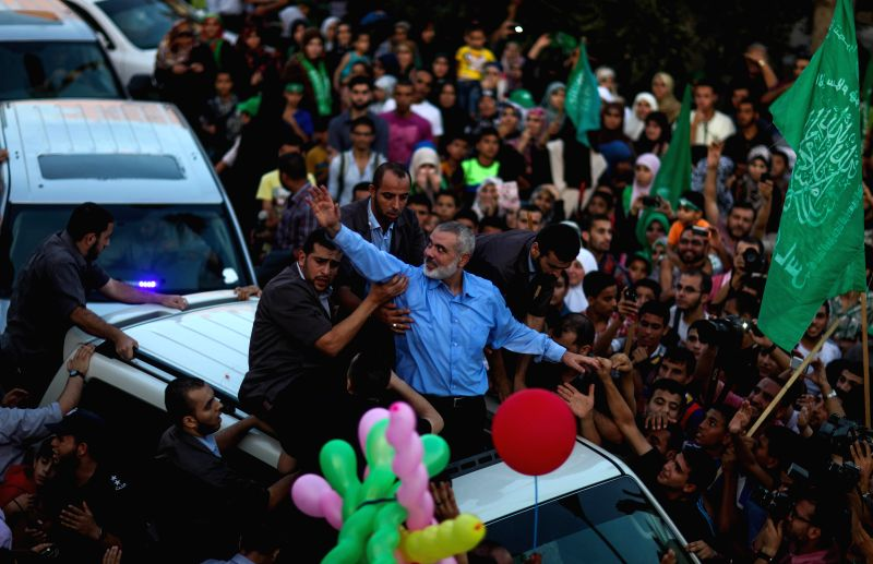 Hamas top leader in the Gaza Strip Ismail Haniya (C) waves to the crowd during a rally in Gaza City on Aug. 27, 2014 to celebrate an open-ended ceasefire in the Gaza ..