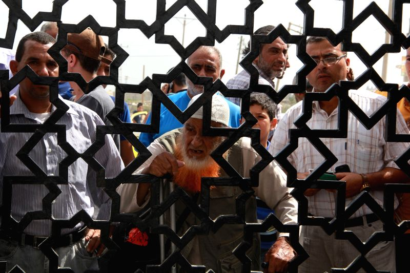 Palestinians who are hoping to cross into Egypt, wait at the Rafah crossing between Egypt and the southern Gaza Strip, Aug. 5, 2014. The Egyptian ceasefire proposal was - Benjamin Netanyahu