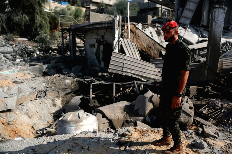 GAZA, Aug. 9, 2018 - A member of Hamas' military person inspects a site that was hit by Israeli airstrikes in Gaza City on Aug. 9, 2018. Israel on Wednesday carried out large-scale airstrikes in the ...