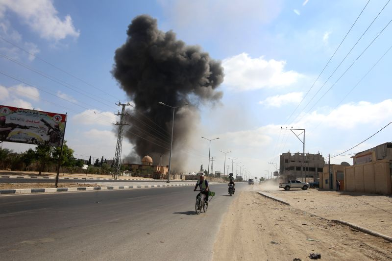 GAZA, Aug. 9, 2018 - An explosion is seen following Israeli air strikes in the southern Gaza Strip City of Rafah, on Aug. 9, 2018. Israel on Wednesday carried out large-scale airstrikes in the Gaza ...