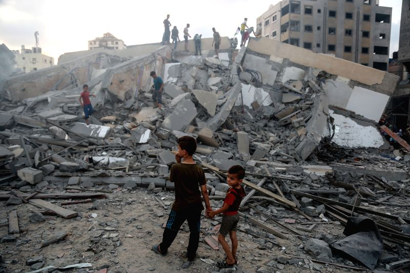 GAZA, Aug. 9, 2018 - Palestinian children look at the rubble of a building following an Israeli airstrike in Gaza City, on Aug. 9, 2018. The Israeli war jets launched 12 successive airstrikes on a ...