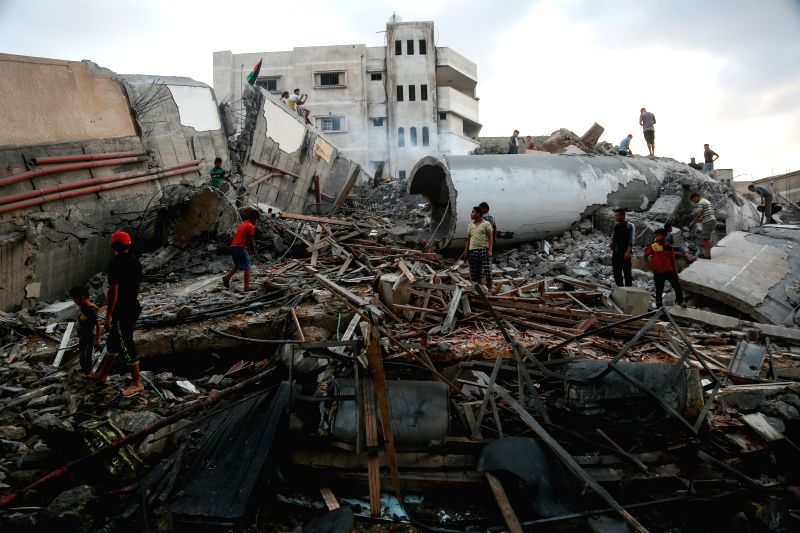 GAZA, Aug. 9, 2018 - Palestinians search in the rubble of a building following an Israeli airstrike in Gaza City, on Aug. 9, 2018. The Israeli war jets launched 12 successive airstrikes on a building ...