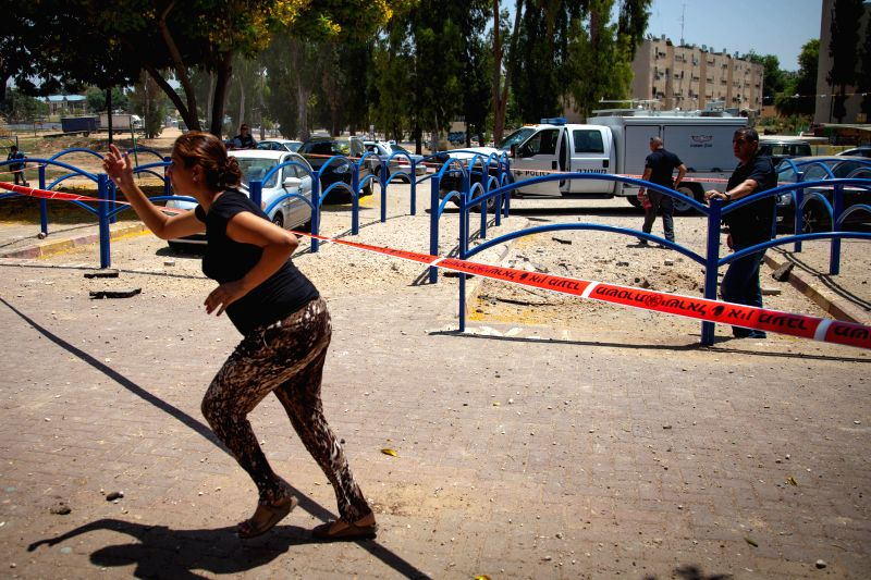 An Israeli woman reacts after a rocket fired from Gaza Strip fell outside a school in the southern Israeli city of Sderot, on July 31, 2014. The Israeli military