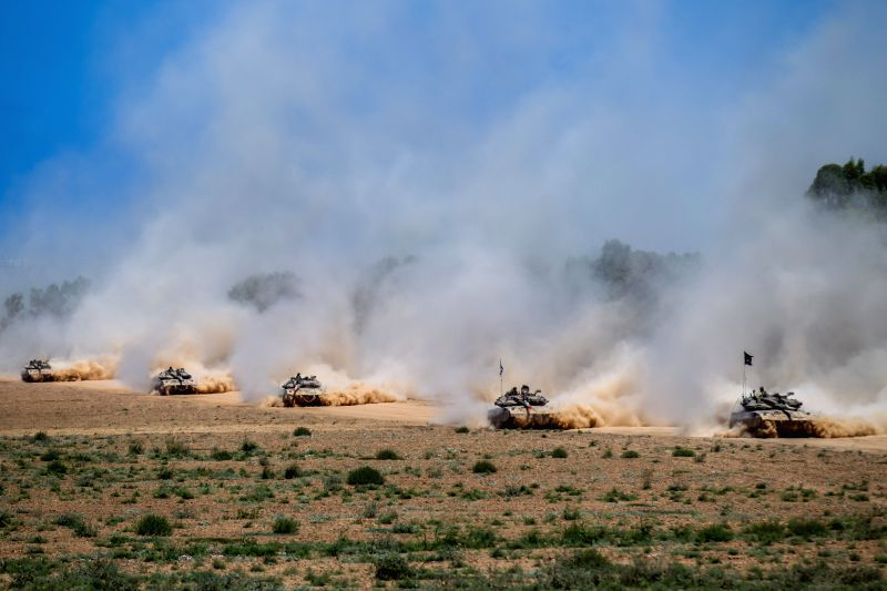 Israeli Merkava tanks pull back from the Gaza Strip to an army deployment area in southern Israel bordering the Gaza Strip, on Aug. 3, 2014. The Israeli military