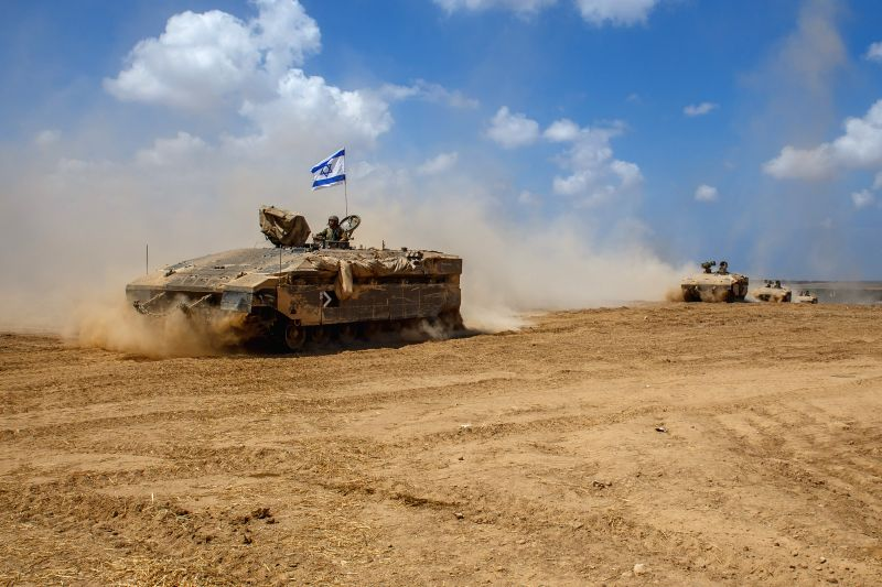 Israeli Armoured Personnel Carriers roll in southern Israel bordering the Gaza Strip as they return from Gaza, on Aug. 4, 2014. The Israeli military said Tuesday