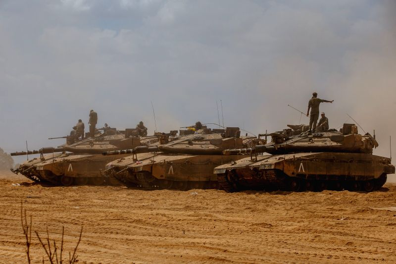 Israeli soldiers are seen atop of Merkava tanks at an army deployment area in southern Israel bordering the Gaza Strip, on Aug. 4, 2014. The Israeli military ...