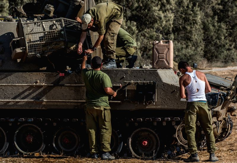 Soldiers repair a self-propelled howitzer in south Israel bordering the Gaza Strip, on Aug. 8, 2014. Israel and the Palestinians have failed to extend the ...