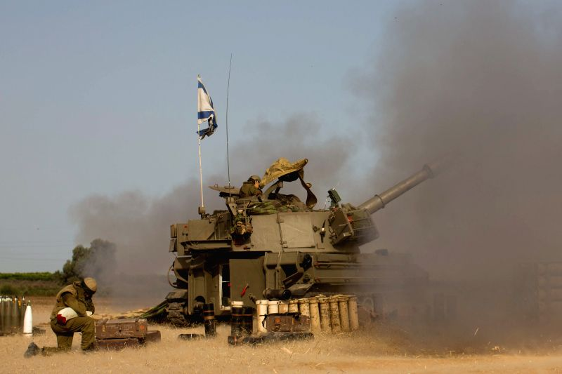 Israeli soldiers on a 155mm M109 Dores self-propelled howitzer fire a shell towards Gaza at a position in Southern Israel near the border with Gaza, on the ... - Moshe Y
