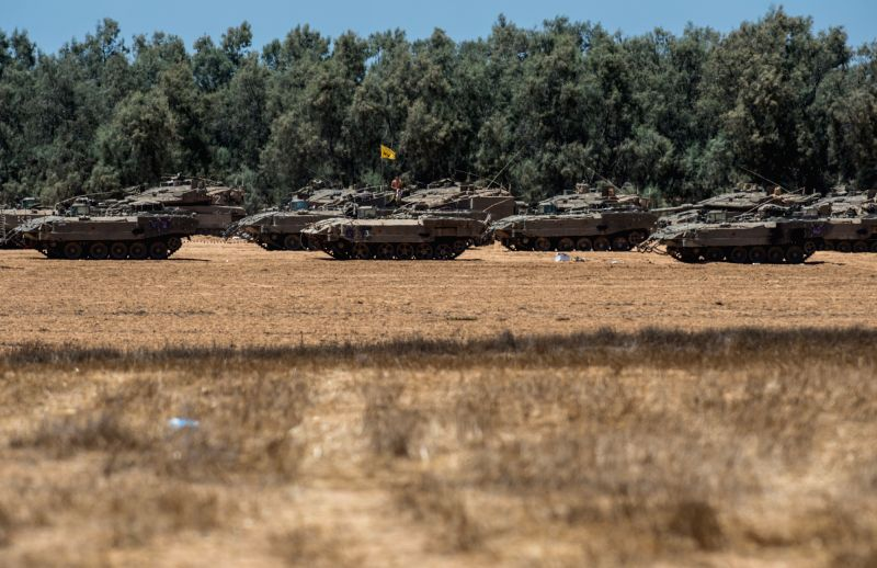Israeli armored vehicles are deployed at a position in Southern Israel near the border with Gaza, on July 14, 2014. Israel's security cabinet decided on Tuesday