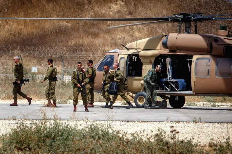 The Israel Defense Forces (IDF) Chief of Staff Banny Gantz (L) arrives at an army base in southern Israel near the border with Gaza, on July 15, 2014. The ...