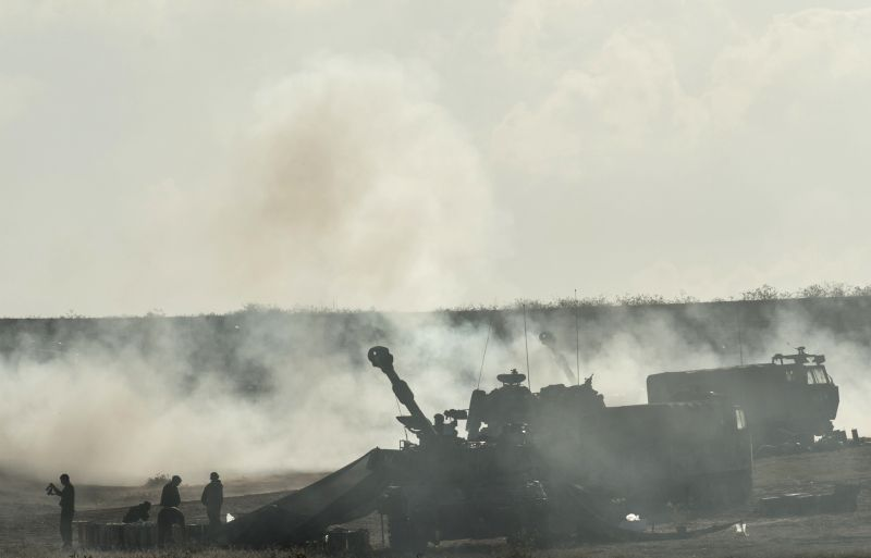 An Israeli self-propelled howitzer fires a shell toward Gaza Strip at a position in southern Israel near the border with Gaza, on the ninth day of Operation ...