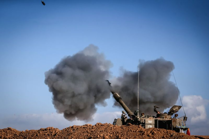 An Israeli 155mm M109 Dores self-propelled howitzer fires a shell to Gaza Strip in the field in southern Israel near the border with Gaza, on the tenth day of ..
