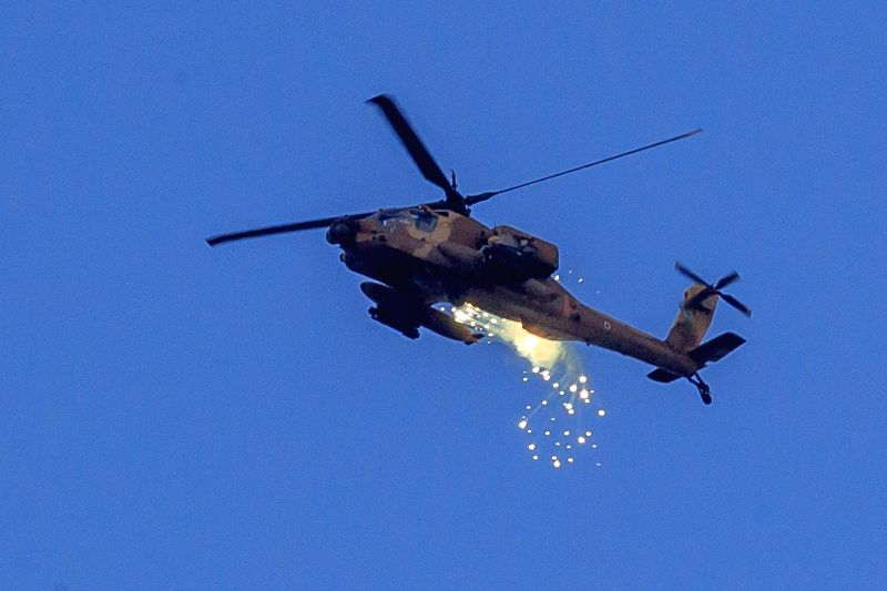 An Israeli Apache helicopter launches flares in the air over southern Israel near the border with Gaza, on the 11th day of Operation Protective Edge, on July ... - Benjamin Netanyahu