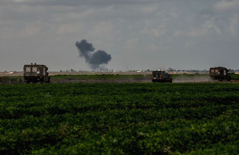 Smoke rises due to an Israeli air strike in the northern Gaza Strip, on July 18, 2014, the 11th day of Operation Protective Edge. Israeli Prime Minister ... - Benjamin Netanyahu
