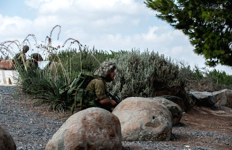 Israeli soldiers take position during an operation at an outpost in southern Israel near the border with Gaza, on July 19, 2014, the 12th day of Operation ...
