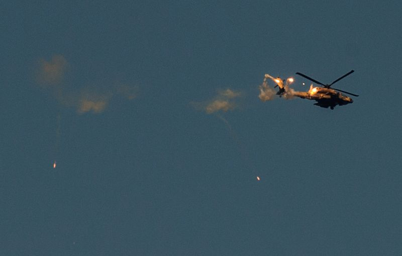 An Israeli Apache helicopter launches flares in the air over southern Israel near the border with Gaza, on July 20, 2014. Thirteen Israeli soldiers were killed .