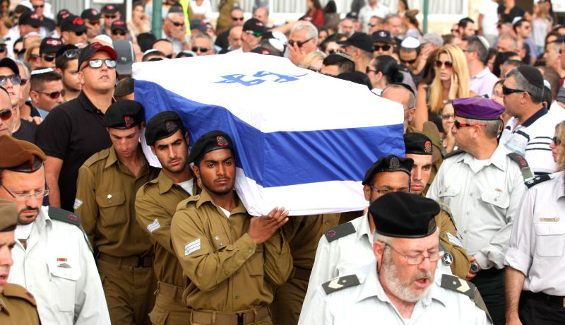 Israeli soldiers carry the coffin of Major Amotz Greenberg, a 45-year-old reserve soldier killed fighting a group of Palestinian militants who infiltrated ...