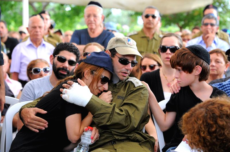 Sagit, the wife of Major Amotz Greenberg, a 45-year-old reserve soldier killed fighting a group of Palestinian militants who infiltrated Israel through a tunnel
