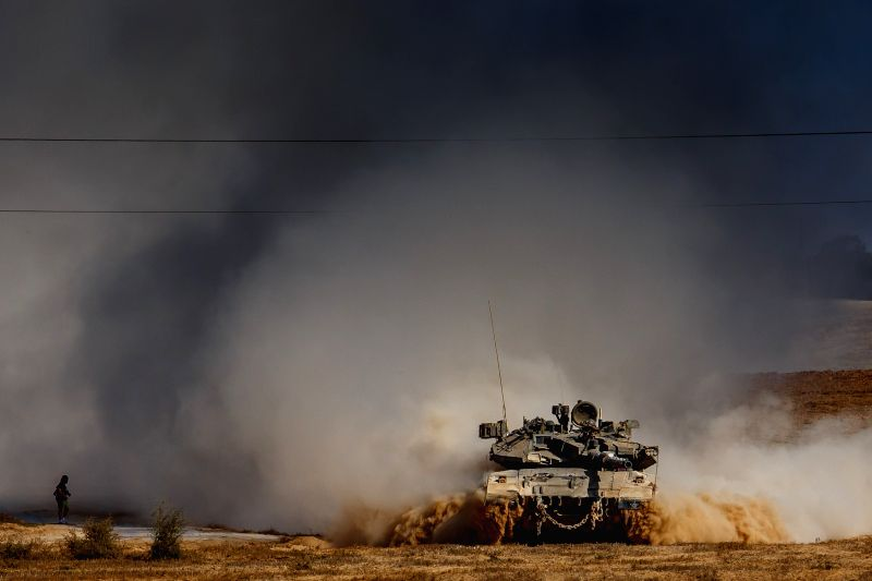 An Israeli Merkava tank rolls at an army deployment area in southern Israel near the border with Gaza, on the 17th day of Operation Protective Edge, on July 24,