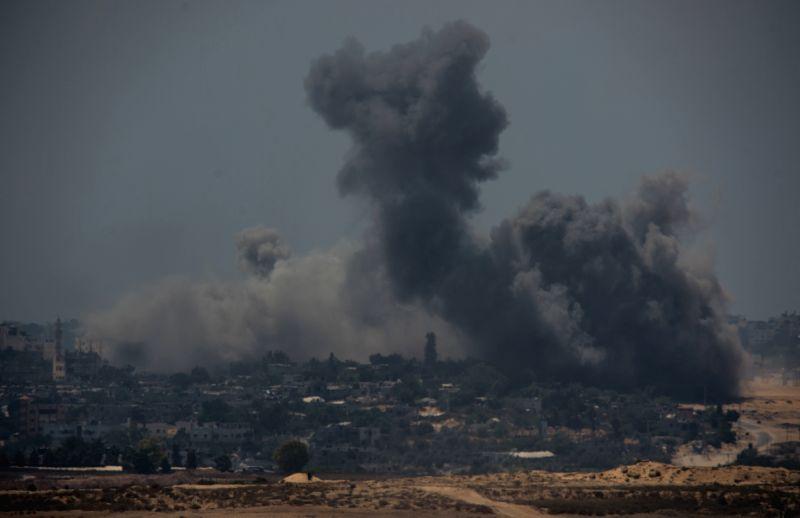 Smoke rises following Israeli airstrikes in northern Gaza Strip seen from Sderot, south Israel bordering the Gaza Strip, on July 27, 2014. UN Secretary-General .