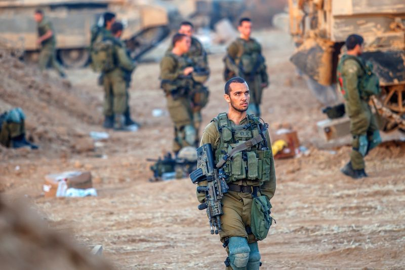 Israeli soldiers from the Golani Brigade are seen at a staging area before entering Gaza from Israel, on July 30, 2014. Israeli Prime Minister Benjamin ... - Benjamin Netanyahu