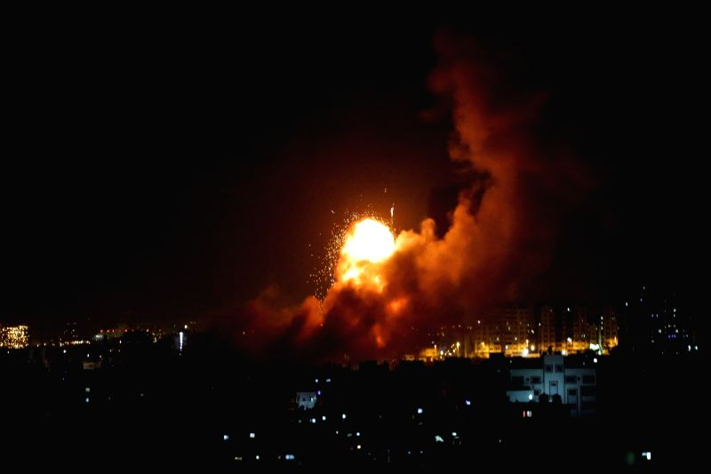 """GAZA CITY, Aug. 8, 2018 - Smoke rises following Israeli air strikes in Gaza City, on Aug. 8, 2018. Israel on Wednesday carried out large-scale air strikes in the Gaza Strip, targeting """"12 terror ..."""