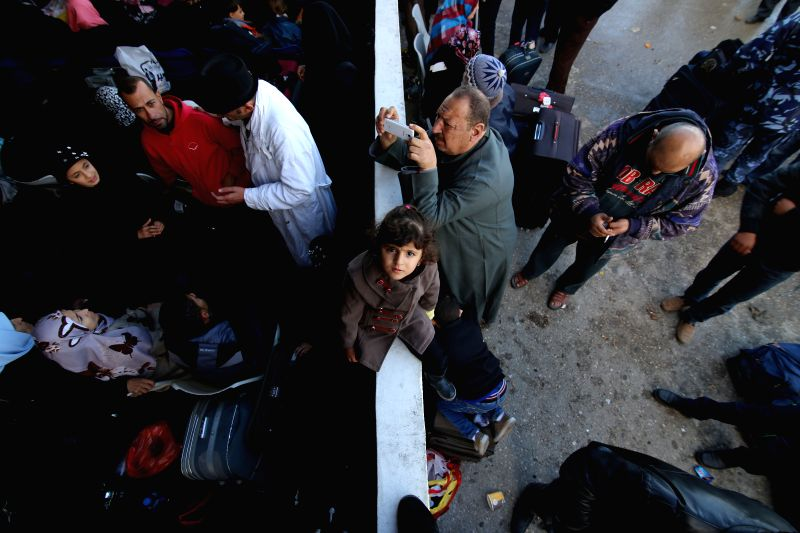 A Palestinian girl, hoping to cross into Egypt with her family, waits at the Rafah crossing between Egypt and the southern Gaza Strip on Dec. 22, 2014. Egypt ...