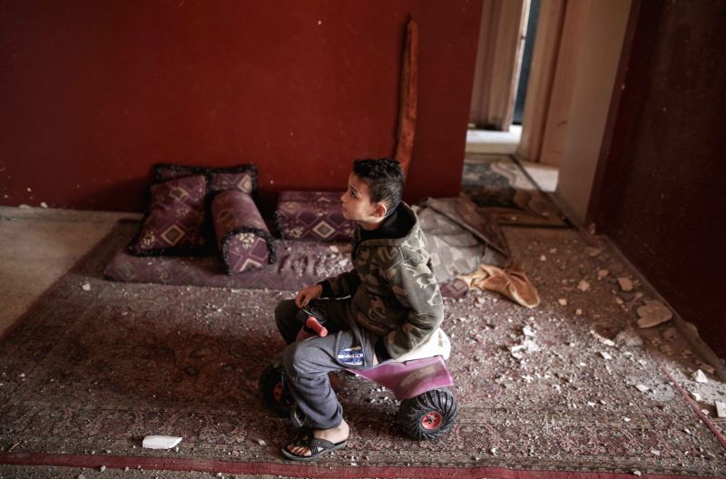 GAZA, Feb. 2, 2018 - A Palestinian child plays in the damaged apartment after an Israeli airstrike in the northern Gaza Strip town of Beit Lahiya, on Feb. 2, 2018. Israeli Air Force attacked a Hamas ...