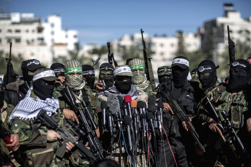 Representatives of various Palestinian armed factions take part in a press conference to condemn an Egyptian court, in Gaza City, on Feb. 5, 2015. The Egyptian court on