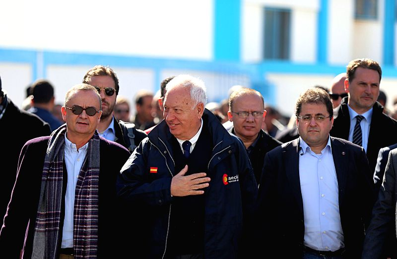 Spanish Foreign Minister Jose Manuel Garcia-Margallo (C) visits a UN-run school in Gaza city, Jan. 13, 2015. Garcia-Margallo visited the Gaza Strip on Tuesday and ... - Jose Manuel Garcia-Margallo