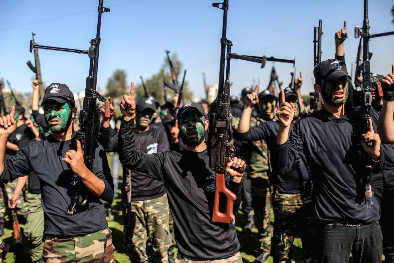 Palestinian youths take part in a graduation ceremony after being trained at Hamas-run camps, in Gaza City on Jan. 29, 2015. Around 17,000 Palestinian youths aged ...