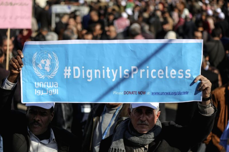 GAZA, Jan. 29, 2018 - Palestinian employees of the United Nations Relief and Works Agency (UNRWA) take part in a protest against the Washington's decision to reduce the fund provided to UNRWA in Gaza ...