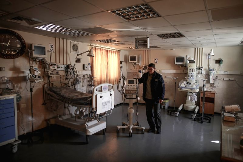 GAZA, Jan. 31, 2018 - An employee of the Palestinian Health Ministry is seen at AL Durra Hospital in Gaza Strip, on Jan. 31, 2018. Seven hospitals in the Gaza Strip were forced to suspend services ...