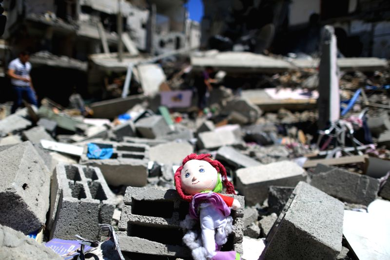 A small toy is seen amid debris of destroyed buildings following an Israeli airstrike in north of Gaza City on July 11, 2014. According to Palestinians medical ...