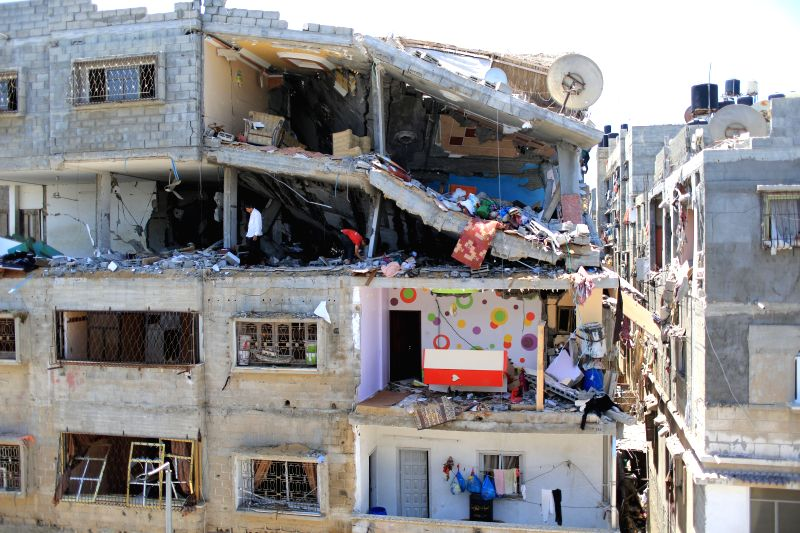 Palestinians inspect the rubble of a house hit by an Israeli airstrike in Gaza City, on July 10, 2014. The health ministry said in a press statement that 81 ...